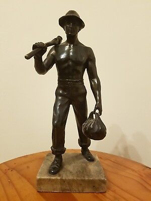 Antique Vintage Cast Metal Miner Statue  Figure With Pick Axe & Lunch bag.