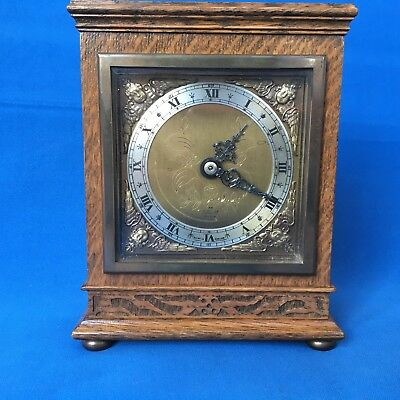 Elliot oak cased mantel clock in excellent condition made in England