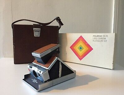 Polaroid sx-70 land camera including leather case and complete accessory kit