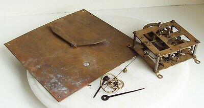 Vintage clock movement and Brass Clock Face