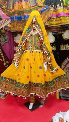raditional Afghan Kochi or Kuchi tribal dress in yellow color for sale.
