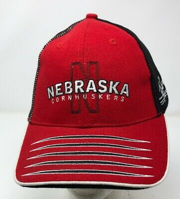 1d9e1921 NEBRASKA CORNHUSKERS DOG EAR Trapper Knit Hat Cap Mossy Oak Break Up ...