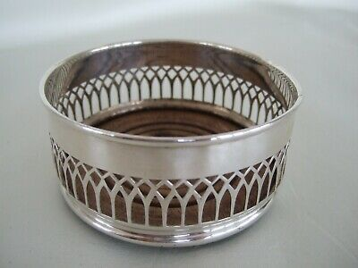 Antique wine coaster pierced silver plate with wood bottom