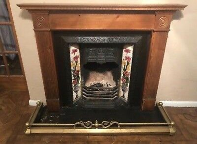 Cast Iron fireplace with wooden surround and brass fender