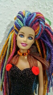 Barbie doll with new hair, outfit and accessories