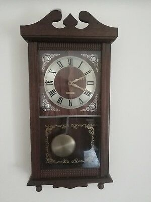 (429)    Large Wooden  Long Case Wall Clock Chimes And As Swinging Pendlium Made