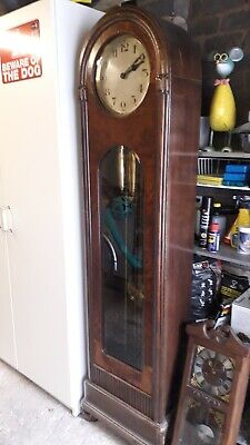Gustov Becker grandfather clock with Westminster Chimes. worn condition
