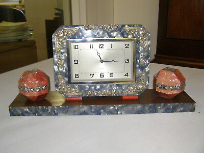 Art Deco wind up clock. 8 day, elegant, time only, makers mark on dial, runs wel