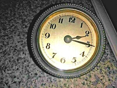 Vintage Clock with bevelled glass front and brass surround