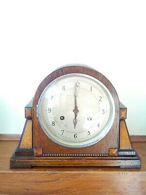 Antique chiming oak case mantel clock spares or repairs.