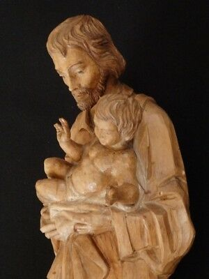 Saint Joseph with the Child Jesus. Carved and partially polychrome wood early 20