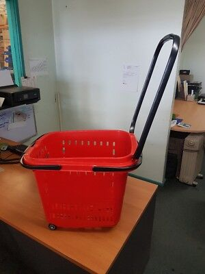Red 50L shopping basket on wheels with regular handles or handle for wheeling