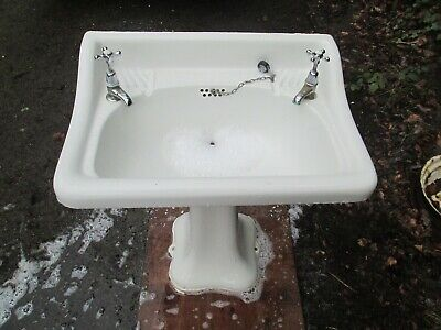 antique wash basin and pedesal with taps