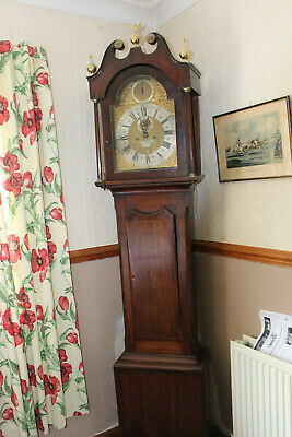 antique Long case clock with brass arched dial