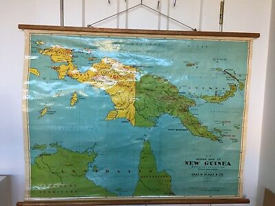 Vintage Industrial Urban Roll Down School Canvas Map Featuring New Guinea