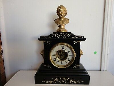 Antique Ansonia cast iron mantle clock with figure, 19th century, working