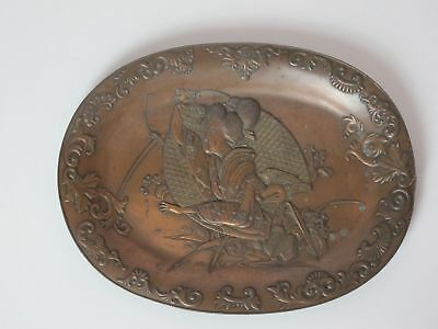 An antique oval shaped Japanese bronze plate with beautiful decorations