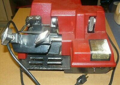 Older Key Cutting Machine by Cole Makes duplicate keys