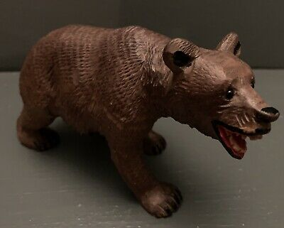 ANTIQUE HAND CARVED BLACK FOREST BEAR WITH GLASS EYES 16cm long c.1900