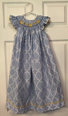 Adorable Smocked Dress Perfect For Any Spring Occasion. Color Is Light Blue.