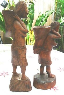 Two old carved Women Carrier Figurines