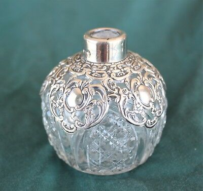 Antique silver covered perfume bottle - no stopper.