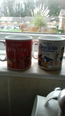 Pair Of Walt Disney Mugs. Lion king and Snow White and the Seven Dwarfs