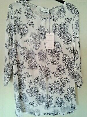 Adini 50/% cotton//50/% polyester burnout pattern button front blouse long sleeves