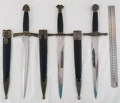 Three daggers with scabbards