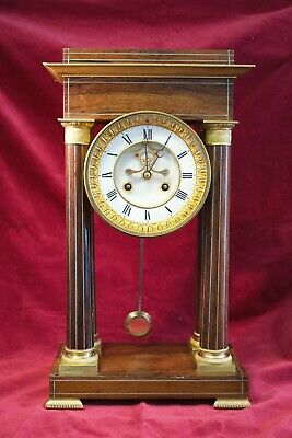 Antique French portico visible escapement clock