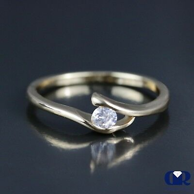 Natural 0.25 Ct. Round Cut Diamond Solitaire Engagement Ring In 14K