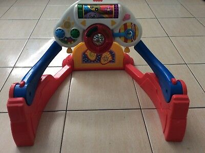 Fisher Price kick n play  car driver floor gym, music,lights. Pickup N Manly