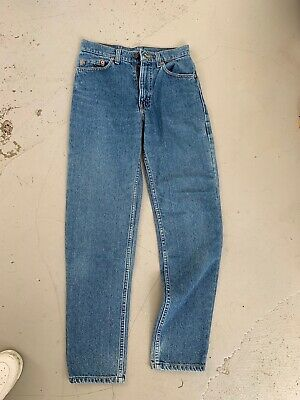 Vintage Levi's Women's High Waisted Jeans. Dark Blue. Size 26. Button Fly.