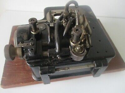 1912 Industrial 3 thread overlock sewing machine by Wilcox and Gibbs