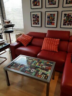 Metal coffee table filled with painted letterpress printing blocks and glazed.