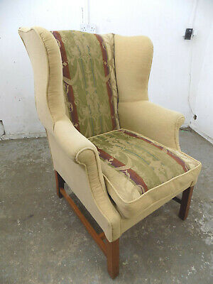 antique,repro,wing back,arm chair,brown,floral fabric,wood legs,feather cushion