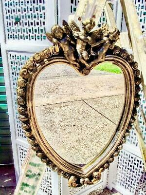 VINTAGE FRENCH LOUIS GOLD HEART SHAPED MIRROR WITH ROSEBUDS AND CHERUBS .  57cm