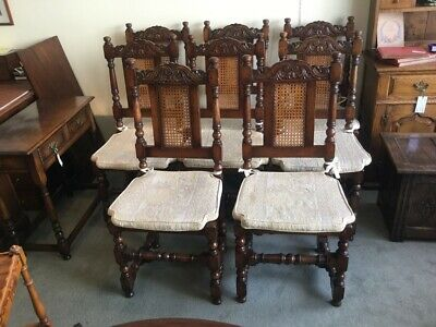 A Set of Eight Oak & Cane Dining Chairs by Titchmarsh & Goodwin