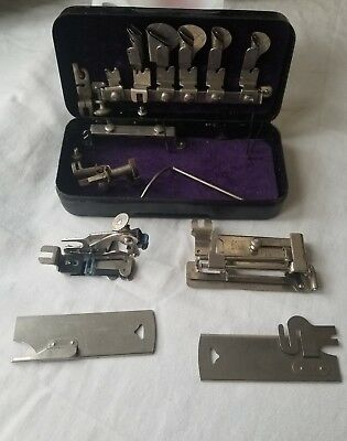 Greist Rotary Sewing Machine attachments in metal box