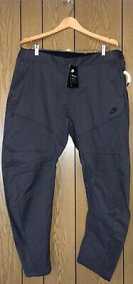 88ee0fd18e3b8 NWT NIKE MENS NSW Tech Pack Woven Track Pant Grey 928573-060 ...