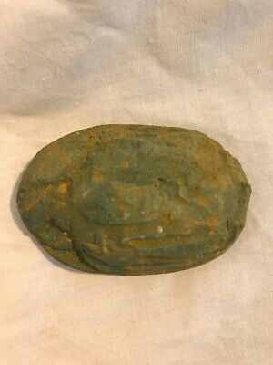 Ancient egyptian glazed scarab with heiroglyphs