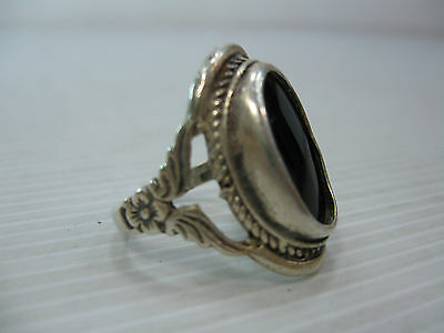 An Old Size 9 Silver Ring With A Dark Polished Stone