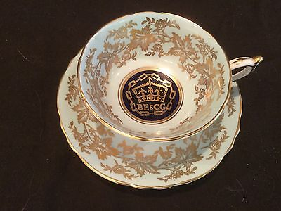 Paragon Made In England Lt. Blue And Gold Tea Cup And Saucer Commonwealth Games