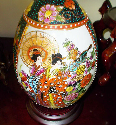 Large Asian Geisha Cloisonne Egg with Stand Handpainted with Gold Color Outline.