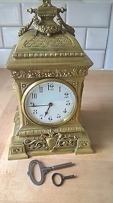 Beautiful ornate brass 8 day clock with 2 keys working nicely decorated solid