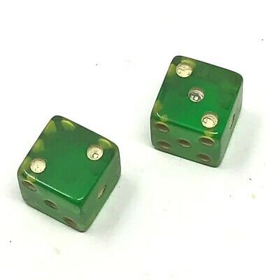 Pair of vintage bakelite or lucite green dice