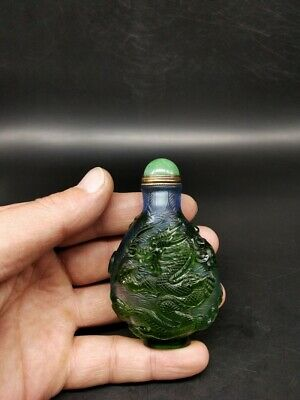Collectable Green Colored glass snuff bottle with spoon carving dargon statue