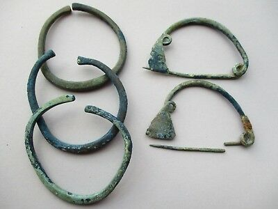 ancient group of Hallstatt bronze three bracelets, and two brooch - fibulas