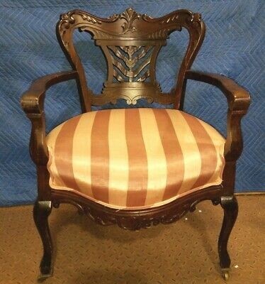 Antique Carved Upholstered Armchair on Wheels