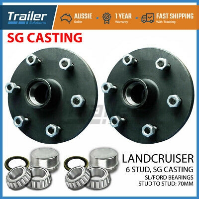 Pair Landcruiser 6 stud trailer hubs 6/139.7 with Ford SL bearings. SG CASTING